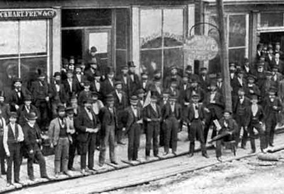 Traders pose for a photo in Oil City, Pennsylvania - 1870 (click for more info)