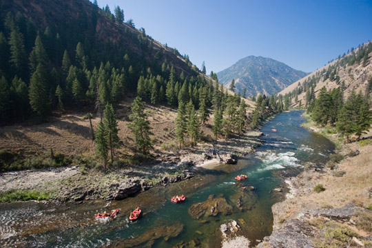 Rafters approach a bend in the Salmon River, deep in the mountains of Idaho.